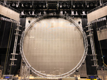 Installation Of Professional Sound, Light, Video And Stage Equipment For A Concert. Stage Lighting Equipment Is Clamped On A Truss For Lifting On Led Screen Background.