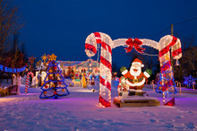 Santa Claus And Other Holiday Decorations And Lights In The Snow In North Rustico, Prince Edward Island, Canada.