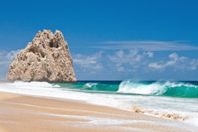 A Wave Crashes On Divorce Beach Near Land's End, Cabos San Lucas, Mexico.