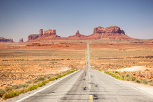 View Of Road In American Desert Landscape Against Clear Blue Sky