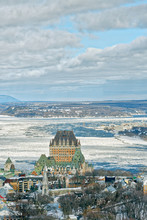 An Aerial View Of Quebec City From The Ciel Rotating Restaurant, With The Chateau Frontenac And Price Building With The Frozen St Lawrence River Beyond