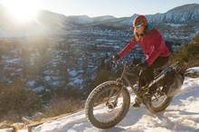 A Woman Riding A Fat Tire Bike On A Trail Above The Town Of Durango, Colorado.