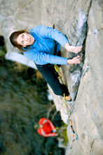 Mitch Underhill Belaying Sarah Felchlin Above Owens River While Climbing In Owens River Gorge Near Bishop, California.