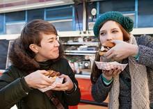 Two Women Eating Hamburgers Outdoors