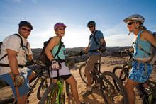 L To R; Tim Bateman, Jessica Reilly, Mark Trevithick, And Julia Ramsden Taking A Break While Mountain Biking On The Slickrock Bike Trail, Moab, Utah