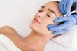 Leinwandbild Motiv Beauty procedure. Woman receiving hyaluronic acid injection