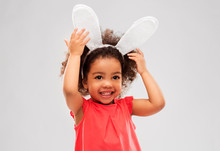 Childhood, Party Props And Easter Concept - Happy Little African American Girl Wearing Bunny Ears Headband Over Grey Background