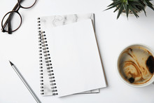 Flat Lay Composition With Notebooks And Coffee On White Background
