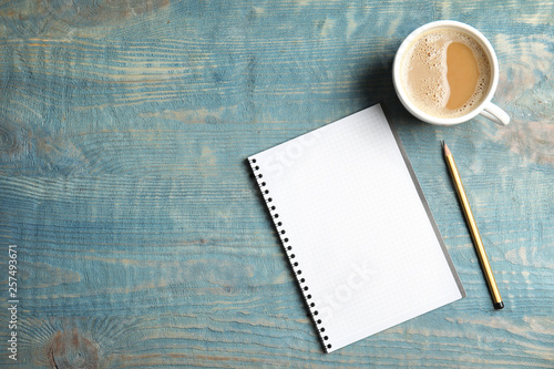 Obraz Notebook and coffee on wooden background, top view with space for text - fototapety do salonu