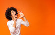 canvas print picture Young african-american man yelling on orange background