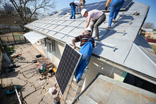 Male Team Workers Installing S...