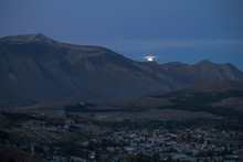 Full Moon Rising Over Mountain Valley Town At Dusk, Esquel, Chubut, Argentina