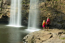 A Woman And Daughter Hikiing Below Waterfall In Fall Creek Falls State Park, Pikeville, Tennesee.