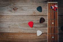 An Acoustic Guitar Fretboard A...