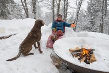 Woman Playing With Dog On Snow, Durango, Colorado, USA