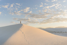 Woman Standing On Top Of Sand Dune, White Sands National Monument
