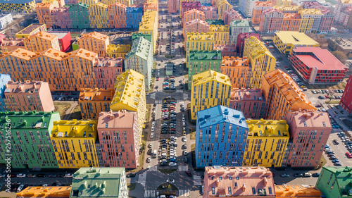 Poster Amsterdam panoramic aerial view of colorful (red, green, blue, yellow) buildings on city street. drone shot