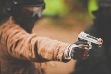 A Man Points An Airsoft Pistol.