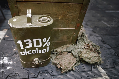 Fotomural  Vintage army canteen and flask labeled alcohol 130 percent