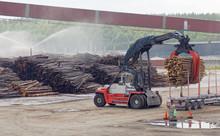 Large Machine Loading Timber A...