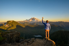 Hiker With His Hat Off To Mount Rainier
