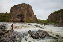 Hiker Near River And Rock Formation In Palouse Falls State Park, Washington State, USA