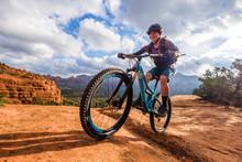 Female Mountain Biker Riding A...