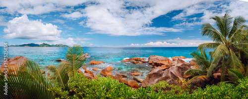 Aluminium Prints Blue Impressive cloudscape panorama of La Digue wild rocky shore and Praslin Island on horizon. Seychelles.