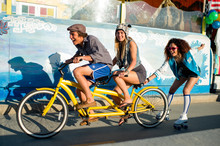 Young Man Pedals Tandem With G...