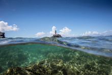 Angler Jonathan Jones Stands On A Reef Outcropping While Fly Fishing Inshore In Samoa.