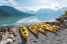 Kayaks On Shore In Norwegian Fjord In Sognefjord, Norway