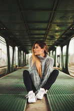 Young Woman  Sitting In An Abandoned Train Car