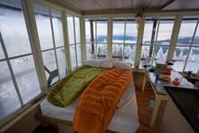 Sleeping Bags On Bed Inside Pickett Butte Fire Lookout Near Tiller, Oregon, USA