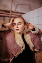 Portrait Of A Woman In A Fur Coat In The Bathroom