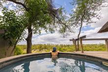 Woman Relaxing In Swimming Pool At Londozi Safari Lodge, Sabi Sands Game Reserve, Mpumalanga, South Africa