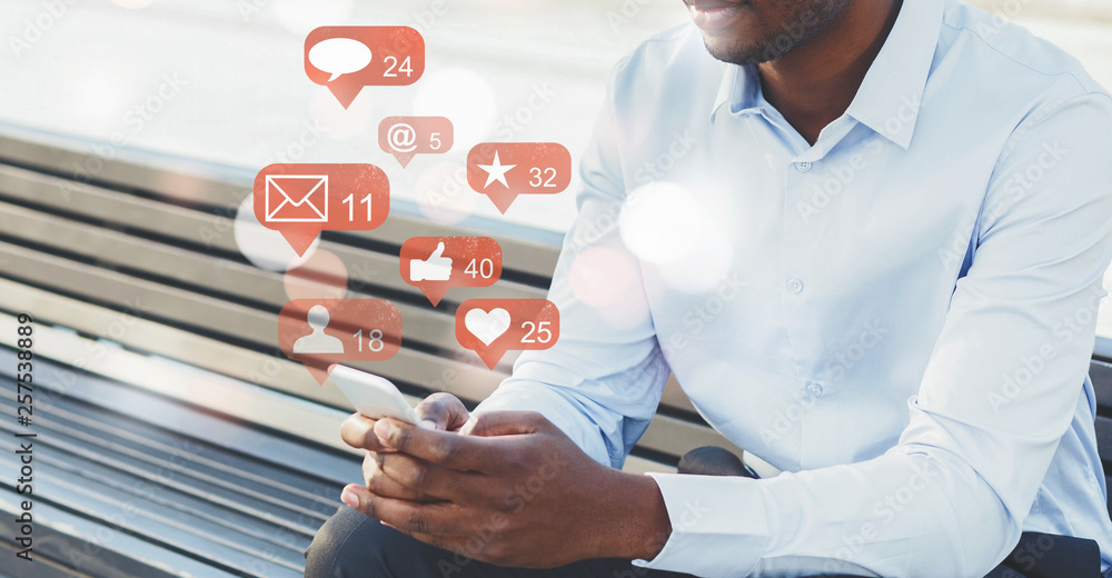 Fototapeta Businessman using social media with notification icons
