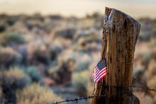 American Flag Stuck In Wooden Log
