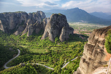 Road Winding Through Stone Towers And Ancient Monasteries Of Kalambaka In Meteora Region, Greece