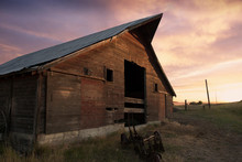 A Beautiful Old Barn At Sunset