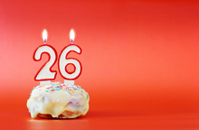 Twenty Six Years Birthday. Cupcake With White Burning Candle In The Form Of Number 26. Vivid Red Background With Copy Space