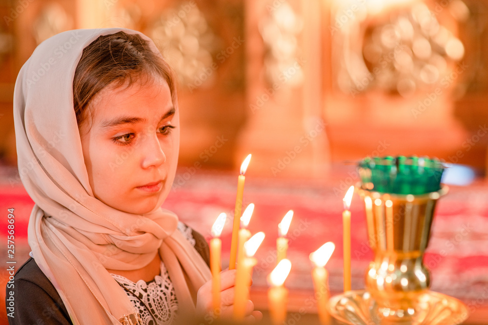 Fototapety, obrazy: Little girl with candle in church