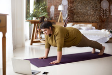Young Woman Doing Yoga At Home...