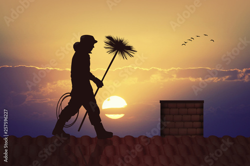 Fotografiet chimney sweep silhouette at sunset