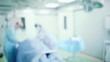 Blurred background of surgical operation of a surgeon in a medical operating room.