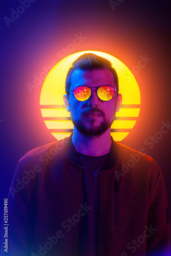 80s sci-fi futuristic fashion poster style violet neon. Retro wave synth vapor wave portrait of a young man in sunglasses.