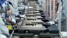 Line Assembly Of TVs. Selective Focus In The Center
