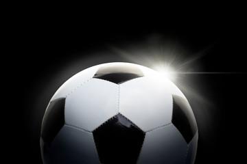 Piłka nożna na czarnym tle