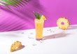 canvas print picture - iced pineapple punch cocktail in glass on purple background. summer drink.