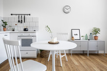 White Chairs And Round Table