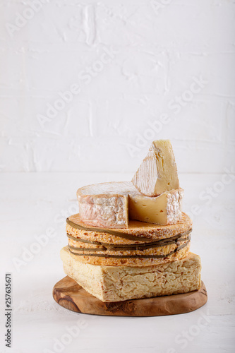 Stack Of Soft French Cow S Milk Cheese On A Cutting Board On White Camembert Livarote Pont L Eveque Cheese From Normandy Copy Space Buy This Stock Photo And Explore Similar Images At Adobe